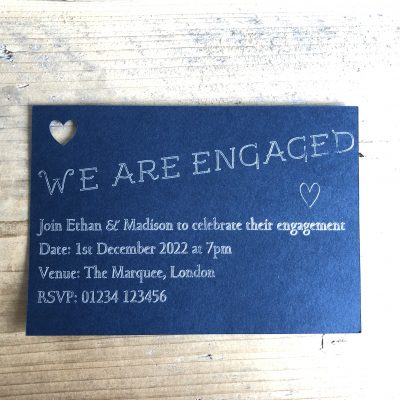 Foil printed engaged invite with cut out heart